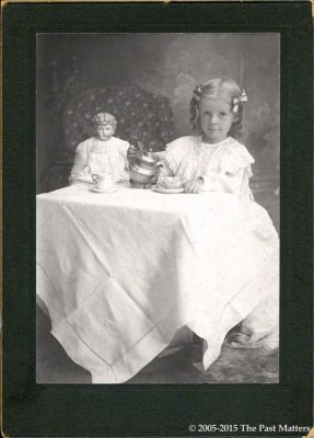 Dana Margaret Williams, 2 Aug 1901, taking tea with her German china doll.