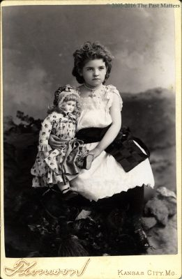 Girl with French bisque Jumeau doll about 1886