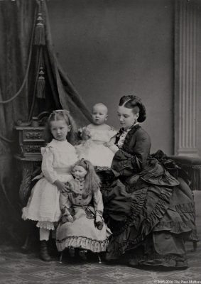 Augusta C. (Bradhurst) Field with her children, Mary P. and William, and a large French bisque Jumeau poupée doll.