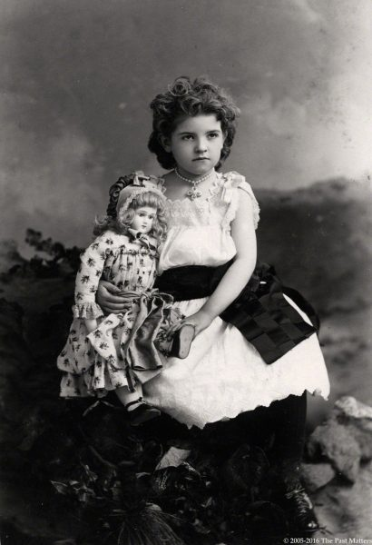 Beautiful little girl with her French bisque Jumeau doll circa 1886