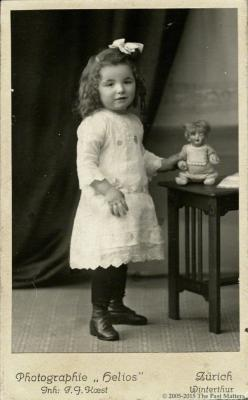 Girl with German bisque character doll